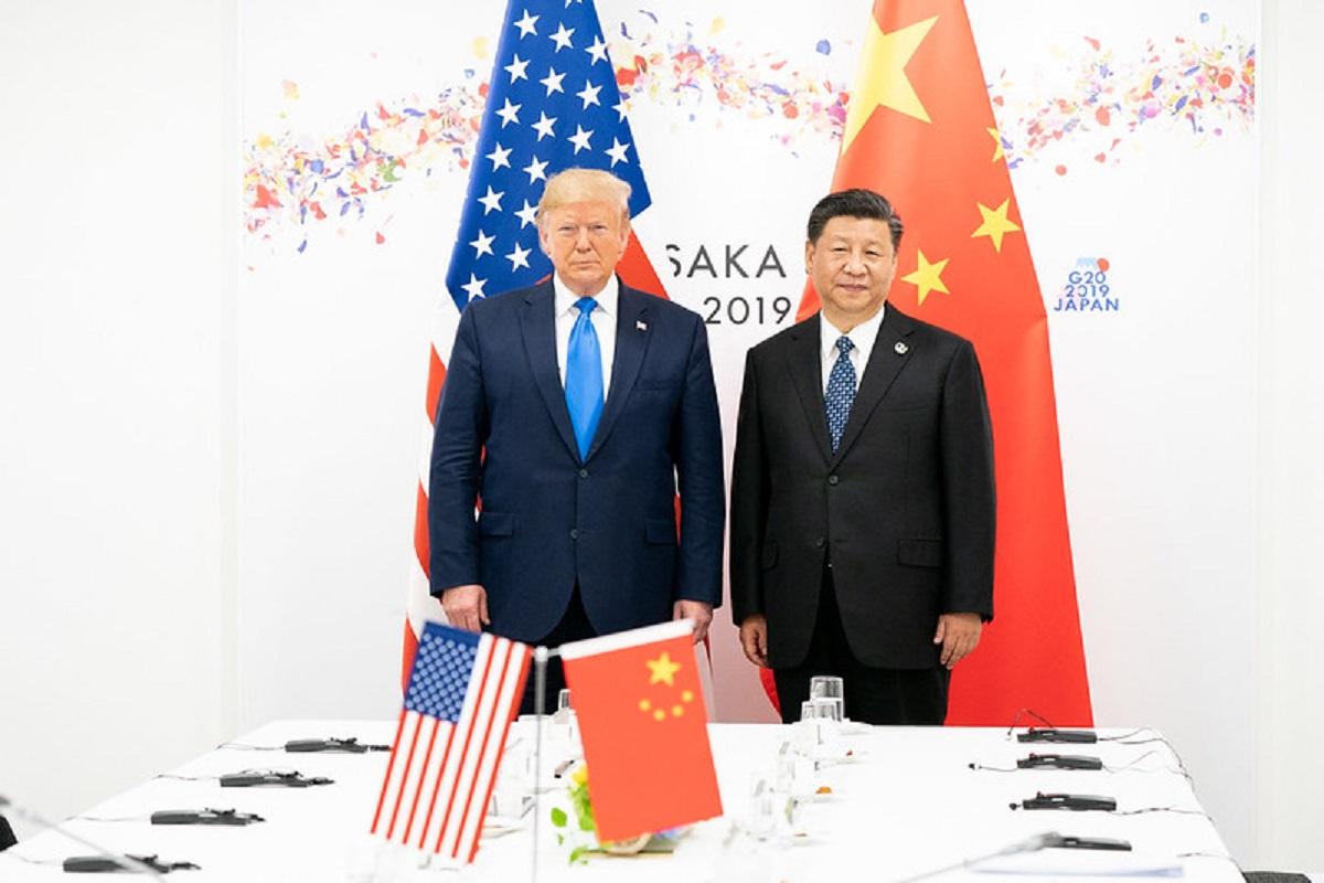 Nepaisant nesutarimų dėl koronaviruso, JAV ir Kinija žada įgyvendinti prekybos susitarimą